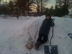 Troop volunteer digs out the hydrant